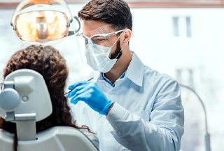 Dentist conducting procedure on patient