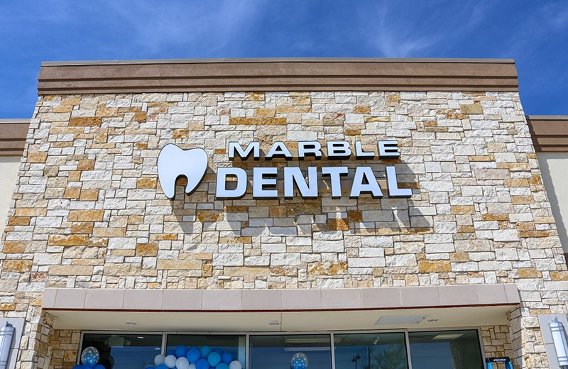 Marble Dental sign on building