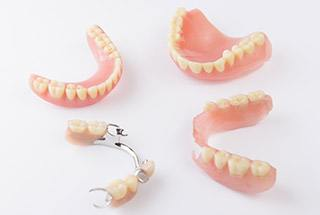 Partial and full dentures on table top
