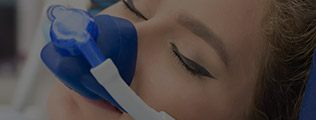 Closeup of patient with nitrous oxide mask