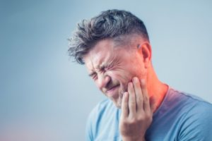 man with toothache who needs emergency dentist in McKinney