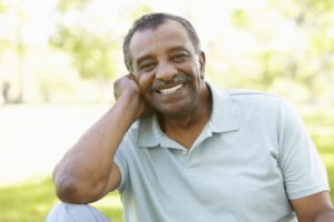 man smiling with dental implants in McKinney