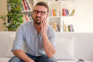 man with tooth pain who needs an emergency dentist in McKinney